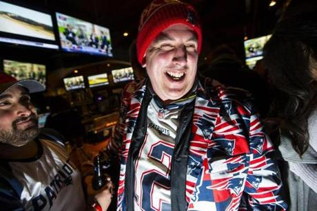 New England Patriots fan Marty Maxwell smiled as he watches pre-game programing for Super Bowl LI in Boston.